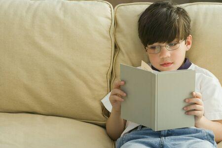 irish ethnicity: Greek boy reading on sofa