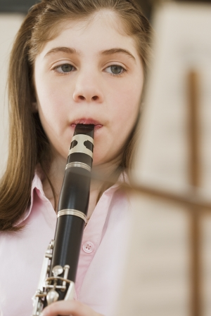musicality: Irish girl playing clarinet