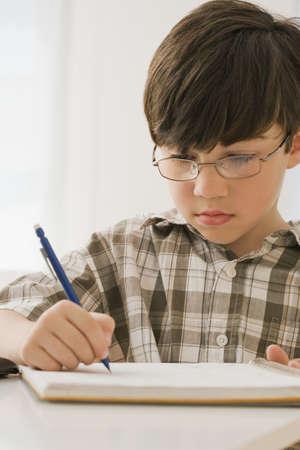 irish ethnicity: Greek boy doing homework