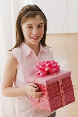 irish ethnicity: Irish girl holding gift