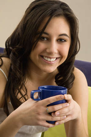 Native American woman holding coffee cup Stock Photo - 16095012