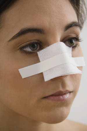 Native American woman with bandage on nose Stock Photo - 16095018