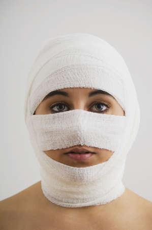 recuperating: Native American woman with bandages around head LANG_EVOIMAGES