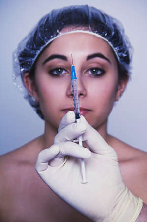 Native American woman looking at syringe Stock Photo - 16095021