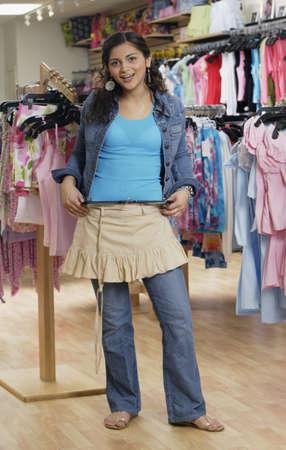 teenaged: Hispanic teenaged girl shopping for clothing