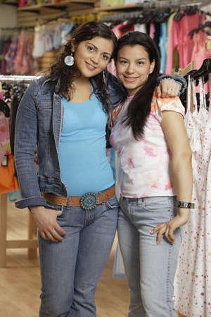 teenaged: Hispanic teenaged girls shopping for clothing