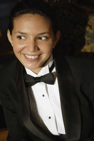 Hispanic female waiter in tuxedo Stock Photo - 16095029