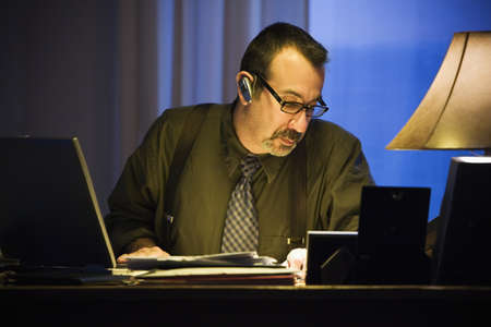Hispanic businessman wearing hands free device Stock Photo - 16095035