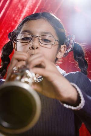 Hispanic girl playing clarinet Stock Photo - 16095040