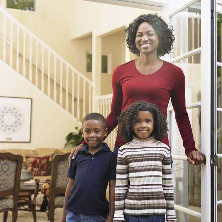 African American mother and children in doorway