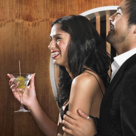 Multi-ethnic couple with martini Stock Photo - 16095054
