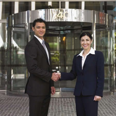 Businessman and businesswoman shaking hands Stock Photo - 16095058