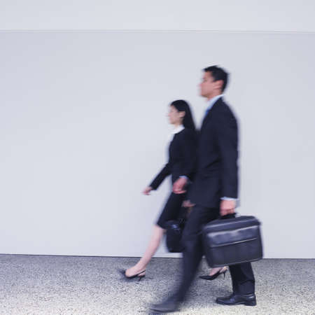 Blurred motion shot of businesspeople walking Stock Photo - 16095063