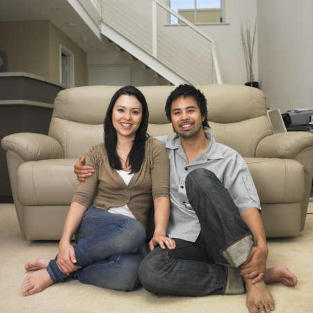Multi-ethnic couple sitting on floor Stock Photo - 16095068