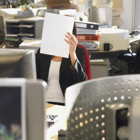 Businesswoman holding paper in front of face Stock Photo - 16095073