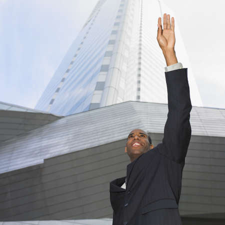 African businessman hailing taxi cab Stock Photo - 16095077