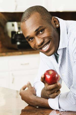 African American man holding apple Stock Photo - 16095103