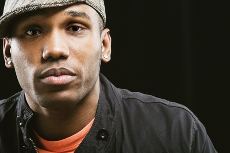 attired: African American man wearing hat