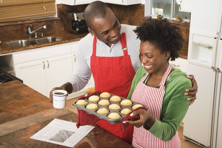 African American couple holding tray of muffins Stock Photo - 16095106