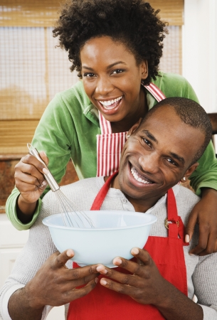 domestic kitchen: African American couple baking in kitchen