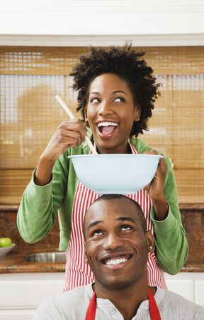 African American couple baking in kitchen Stock Photo - 16095109