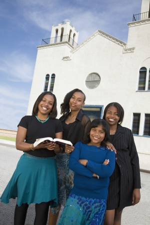 church architecture: African American woman in front of church
