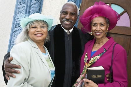 Portrait of senior African American women and Reverend Stock Photo
