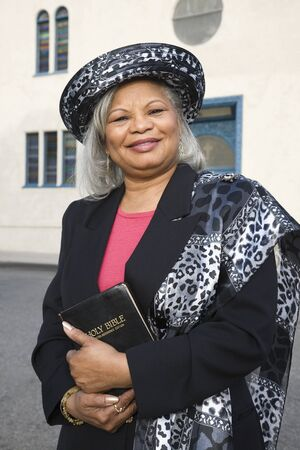 Senior African American woman in front of church Stock Photo - 16095118