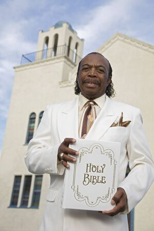Senior African American man in front of church Stock Photo - 16095120