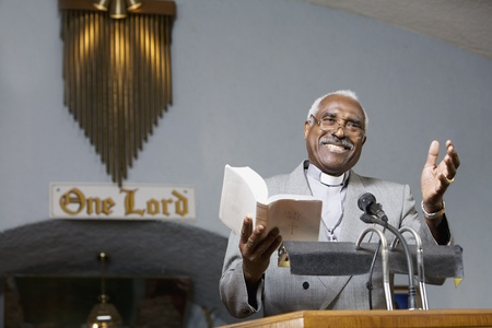 preaching: African American Reverend preaching in church LANG_EVOIMAGES