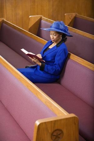 only one senior: Senior African American woman in church LANG_EVOIMAGES