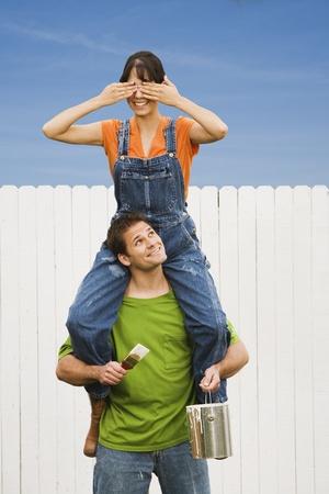 devilment: Woman sitting on boyfriend's shoulders LANG_EVOIMAGES