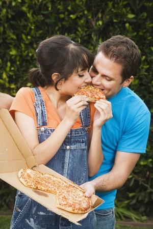 Multi-ethnic couple eating pizza Stock Photo - 16095130