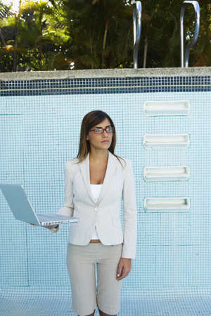South American businesswoman in empty swimming pool Stock Photo - 16095177