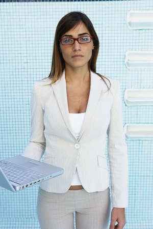 South American businesswoman in empty swimming pool Stock Photo - 16095178