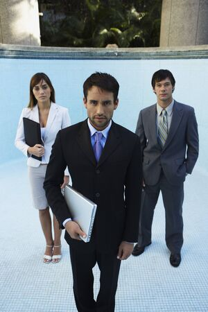South American businesspeople in empty swimming pool Stock Photo - 16095182