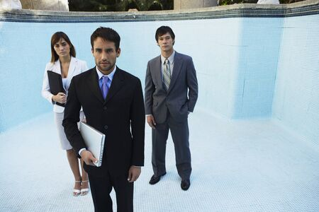 South American businesspeople in empty swimming pool Stock Photo - 16095183