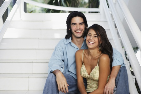 South American couple on stairs Stock Photo - 16095188