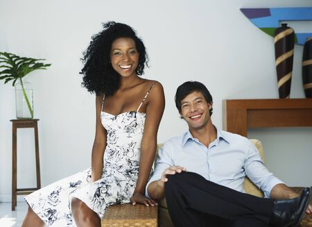 South American couple sitting on chair Stock Photo - 16095191