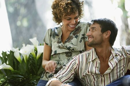 adoring: South American couple smiling at each other LANG_EVOIMAGES