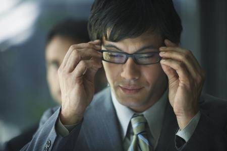 attired: South American businessman wearing eyeglasses LANG_EVOIMAGES