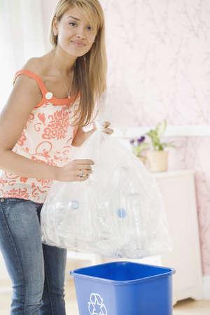 Hispanic woman filling recycling bin Stock Photo - 16095223