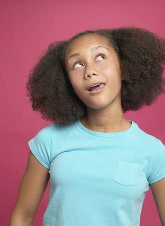 interrogating: African girl looking up LANG_EVOIMAGES