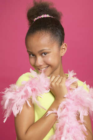 attired: African girl wearing feather boa