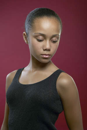anguish: African girl looking down