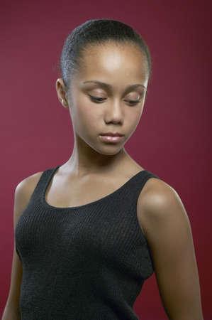 downcast: African girl looking down