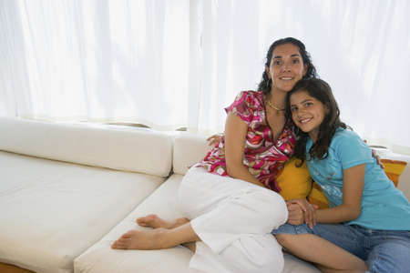 Hispanic mother and daughter hugging Stock Photo - 16095244