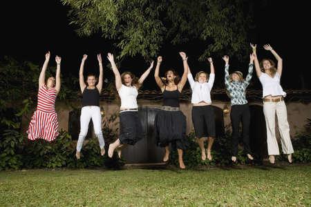 Group of Hispanic women jumping Stock Photo - 16095258