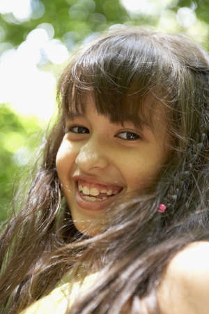 lighthearted: Close up of Hispanic girl smiling
