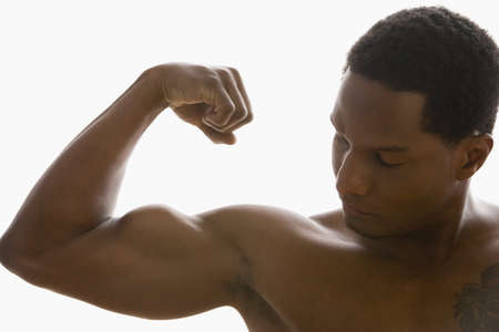 only the biceps: African American man flexing biceps
